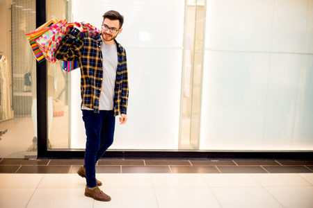 shopper: Guy shopping in a mall