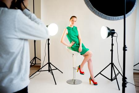 Photogtapher working in studio Stock Photo