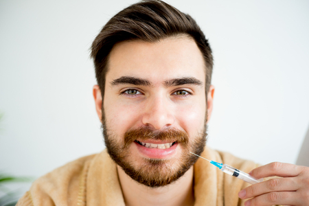 salon and spa: Man facial injection Stock Photo