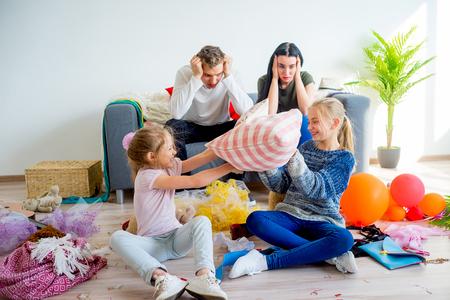 Kids romping at home Standard-Bild
