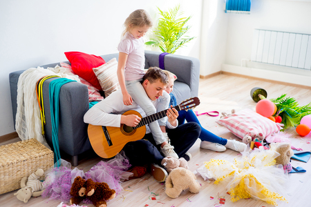 romp: Girls playing with father