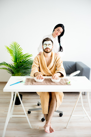 A masseur is doing a massage to a handsome man Stock Photo