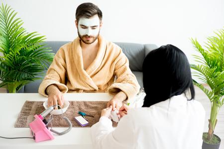 Man doing manicure