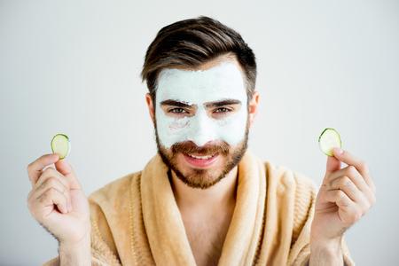 泥マスクを持つ男 写真素材