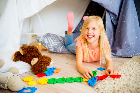 Girl in a play tent Stock Photo