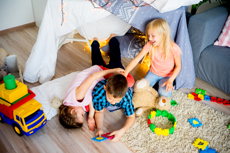 pretending: Kids in a wigwam