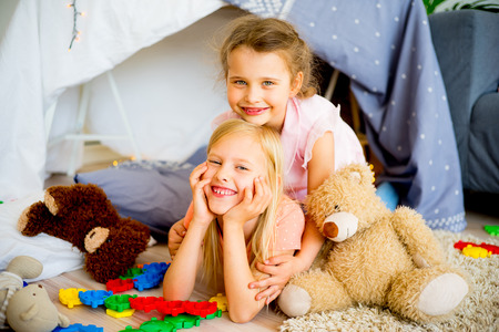 Two sisters in a play tent