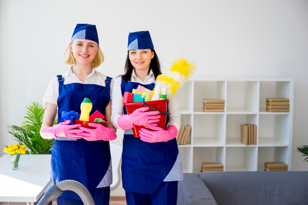 Two girls of cleaning service