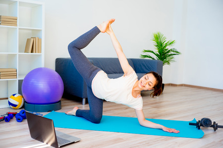 Girl is doing fitness at home