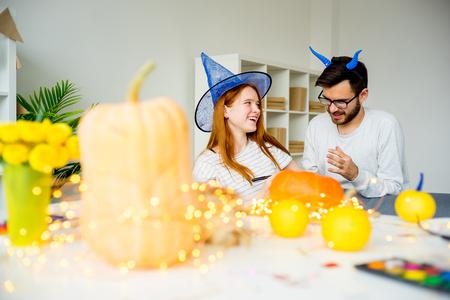 Husband painting pumpkins