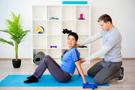 Physiotherapist helping a senior patient Stock Photo