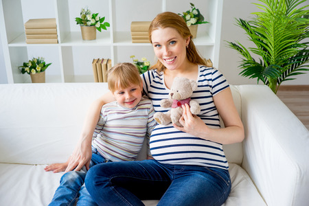 couch: Girl expecting a sister