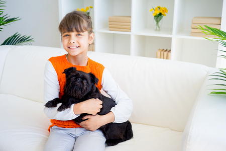 grandaughter: Grandaughter with a dog Stock Photo