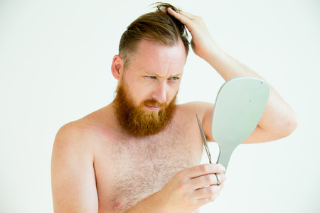 Guy trimming his beard Stock Photo
