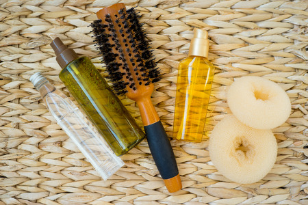 An image of different hairdressing tools combs