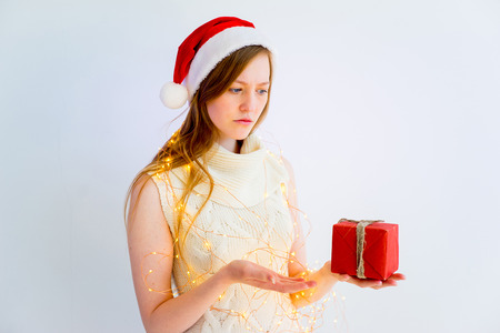 disapprove: Girl doesnt like her gift Stock Photo