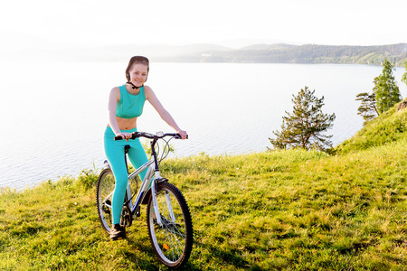 Girl travelling on a bicycle Stock Photo