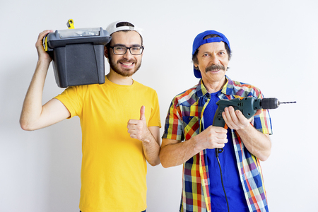 Father and son with carpentry equipments