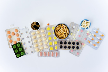 A set of different colorful medication pills