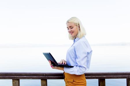 Businesswoman working on a beach Stock Photo