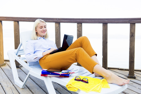 Businesswoman working on a beach Stock Photo