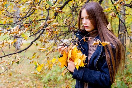 Depressed girl walking in park