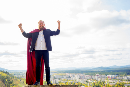 Successful man with a cape Stock Photo
