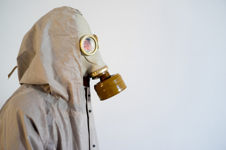 A portrait of people in gas masks in bad ecology Stock Photo
