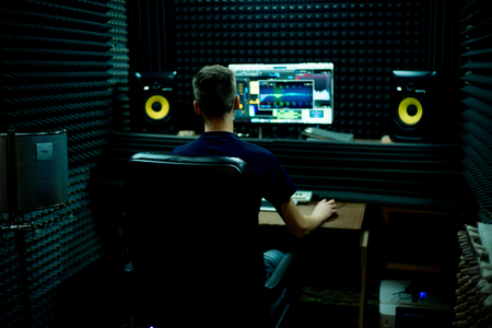 A portrait of a musician in a recording studio
