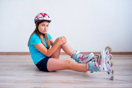 Girl fell on roller skates
