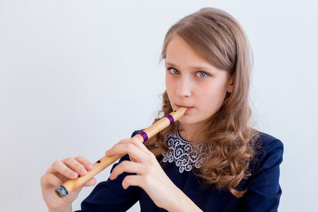 Girl playing on a flute