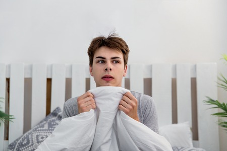 Man waking up late for work, he overslept