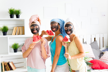 Girls having fun on slumber party together Stock Photo