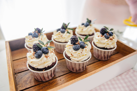 a concept of baking sweet cupcakes and muffins at home