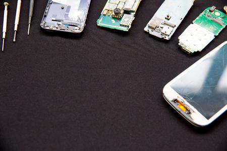 smartphone parts and repairing tools, flat lay, top view