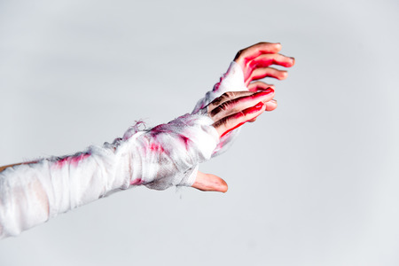 Halloween theme: an image of zombie hands with black nails Stock fotó