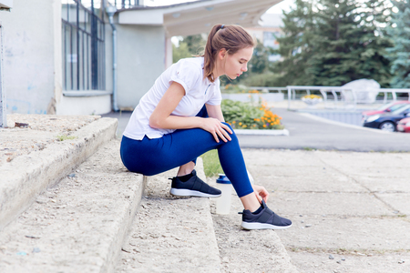 sporty fit girl jogging at park and doing exercises Stok Fotoğraf