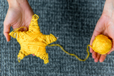a Yellow knitted five-pointed star shaped toy