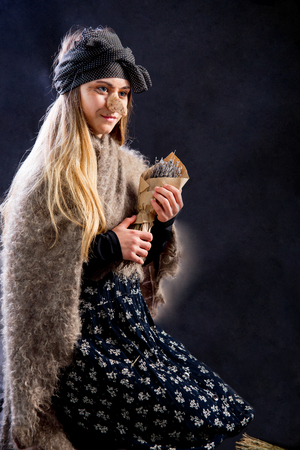 A young woman wearing a witch costume