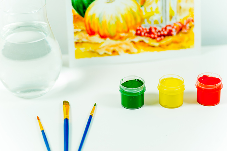 work space on a table with pencils and paintbrushes Stock Photo