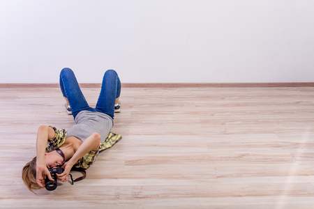 different photographer poses: bending, squatting, lying down Stock fotó