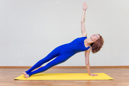 a woman practicing yoga exercises at home