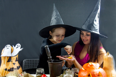 Mother and her daughter wearing halloween costumes