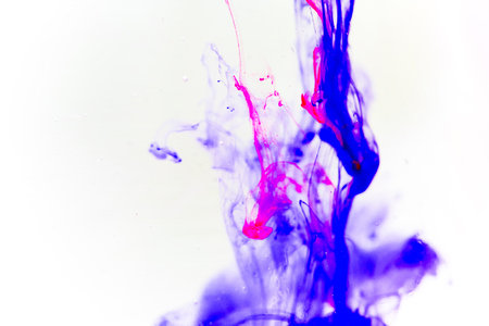 a drop of paint pouring in water