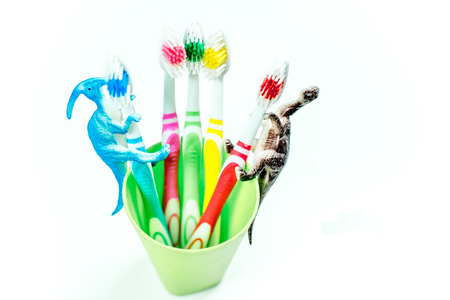 toothbrushes and a toothpaste on a colorful background Stok Fotoğraf