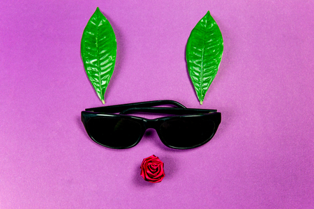Cool black sunglasses with green plant leaves