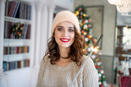 happy young woman is celebrating christmas at home