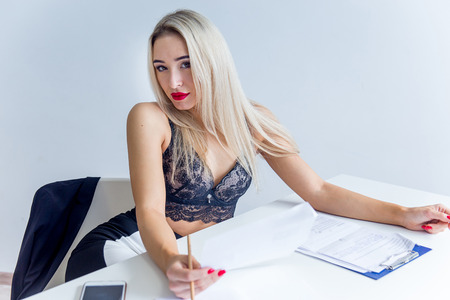 a businesswoman or a secretary in a jacket and lingerie