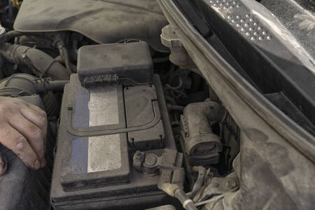 Auto mechanic works in the garage. Repair: Replace Air Filter
