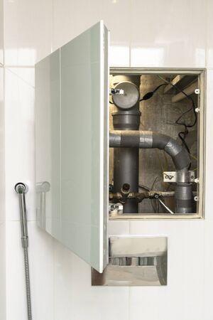 turn off hot water. plumbing cabinet. water meters, collector, water pressure sensor Stock fotó